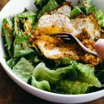 Caesar salad with crispy egg and breadcrumbs